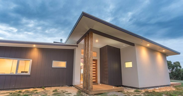 Built by Pivot Homes - A contemporary facade for this large acreage home. Rendered foam in Colourbond 'Dune' works well with the James Hardie Scyon Stria in Colourbond 'Loft'. Reclaimed timber posts are used as a feature for the entrance.