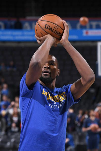 Kevin Durant of the Golden State Warriors warms up before the game against the Oklahoma City Thunder at the Chesapeake Energy Arena on November 22...