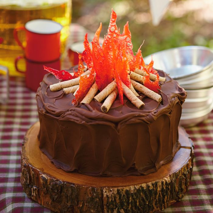 Serve up chocolate Campfire Cake that's topped with crackly hard-candy flames and rolled-wafer cookie logs.