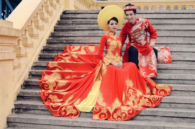 Ao Dai - A traditional Vietnamese Wedding dress. Its a long-sleeved tunic with ankle-length panels at front and back, worn over trousers.  Red is the dominant color in a traditional Vietnamese wedding.