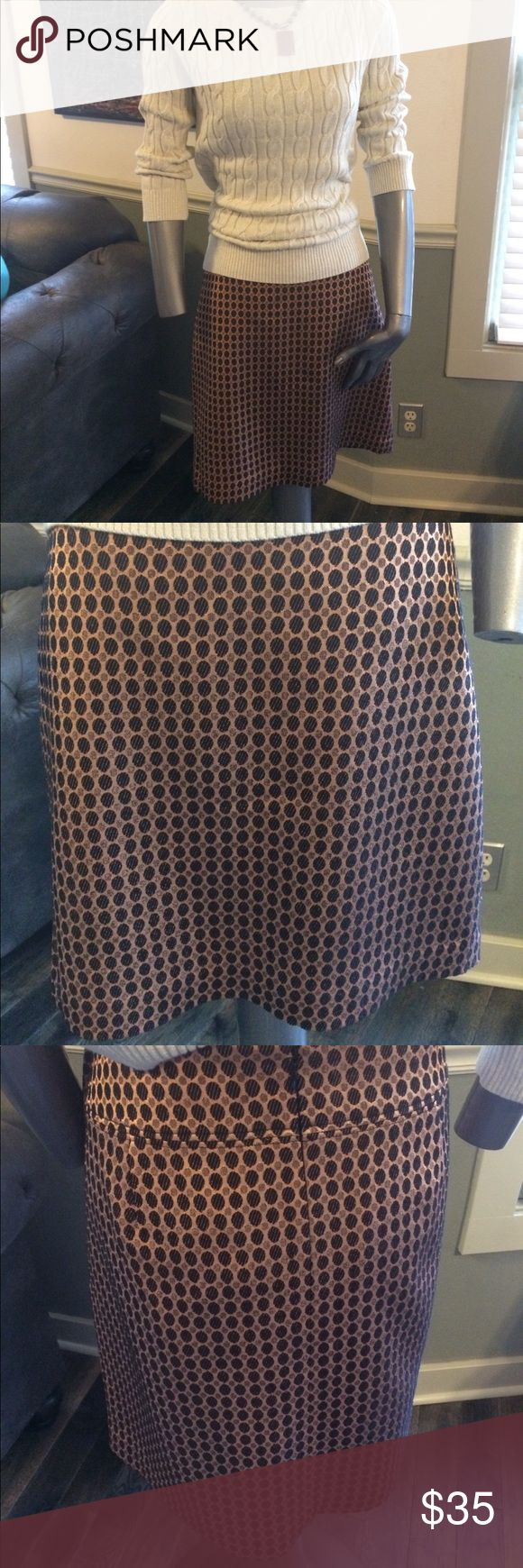 NWT Ann Taylor LOFT Skirt NWT Ann Taylor LOFT Skirt. Coppery color background with two sizes of black embroidered dots. Flat front with banding and darts at waist back for sleek fit that accents figure nicely. Materials--56 % Rayon/ 40% Polyester/ 4% Spandex. Full 100% Polyester lining. Approximately 19 inches from waist to hem when flat. Sharp enough to pair with camisole & blazer or sweater for work and then some spiked heel for a cocktail after. Ann Taylor Skirts