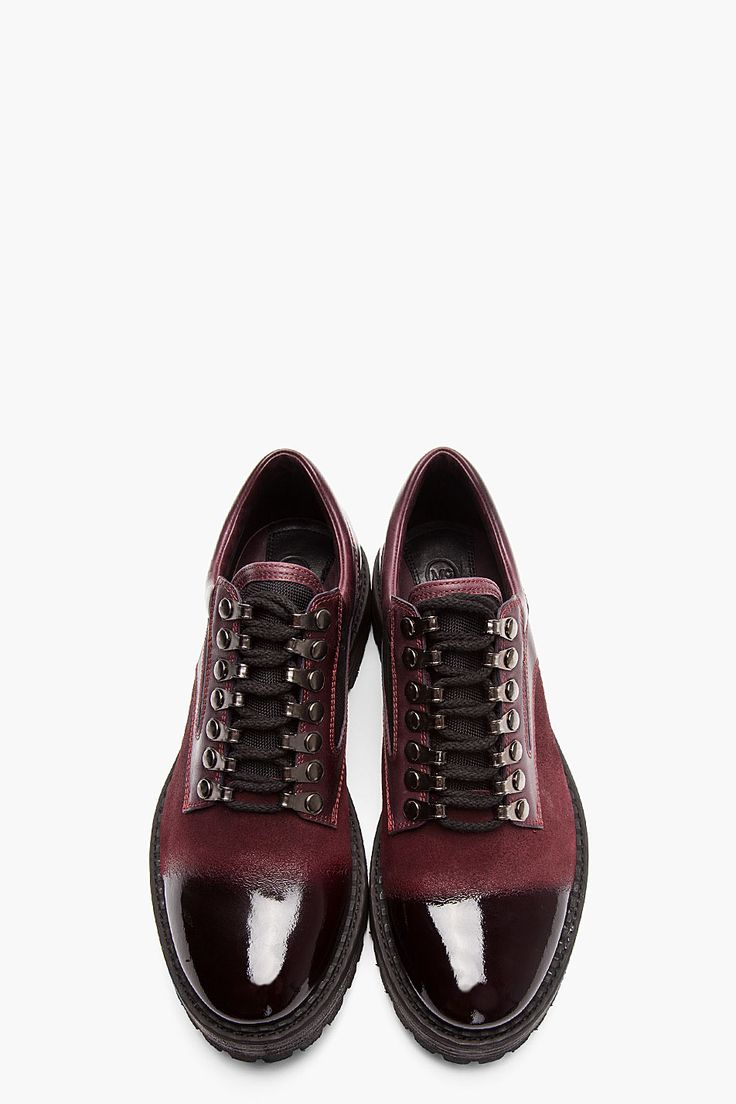 """MCQ ALEXANDER MCQUEEN //  Oxblood Brushed Suede Polished Toe Shoes  32114M002001  Low top brushed suede shoes in oxblood. Round toe. Black lace up closure with black lace hooks. Leather trimmings throughout in oxblood. Polished toe and heel in black. Contrast textile panel in black. Padded collar. Vibram rubber lug sole in black. Tone on tone stitching. Approx 1.5"""" heel. Leather/textile upper, Vibram rubber sole. Made in Italy.  $865"""