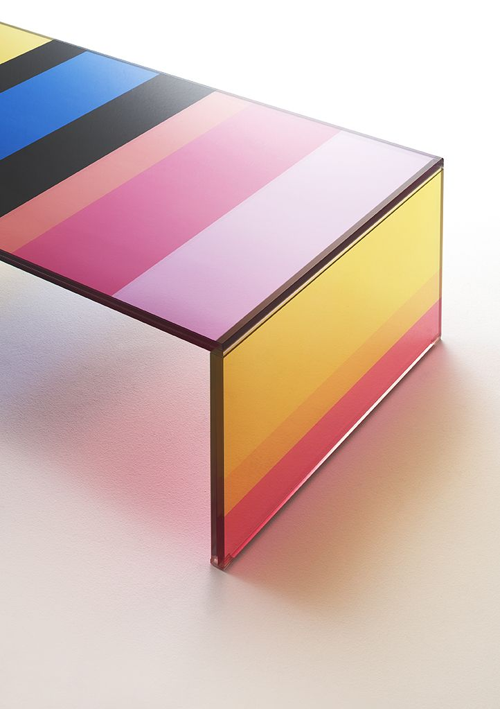 THE DARK SIDE OF THE MOON |  Design: Piero Lissoni  |  Low table with bridge shape in laminated extralight glass with a sophisticated and innovative technical process, thanks to which the top and the sides are characterized by strips of different colours and widths, whose mix generates a kaleidoscopical effect.