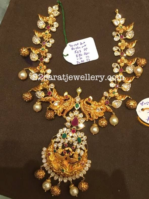 22 carat gold nakshi work large peacocks and pachi work leafy clasps combination broad necklace with filigree design gold balls, south se...