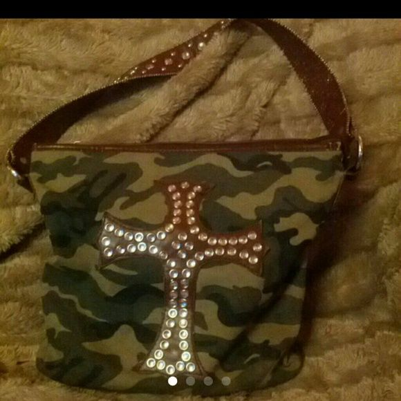 "FINAL MARKDOWN  Cross Camo Purse Cross Camo Purse - no rhinestones or studs missing - 11"" x 11"", 1 large & 2 smaller zipper compartment's inside, see last picture to see best shot at the wear, there are a couple of marks on the bottom - it has more room than you would think. I usually carry big bags because I keep EVERYTHING in my bag  but this one did the job - I was very impressed! Bags"