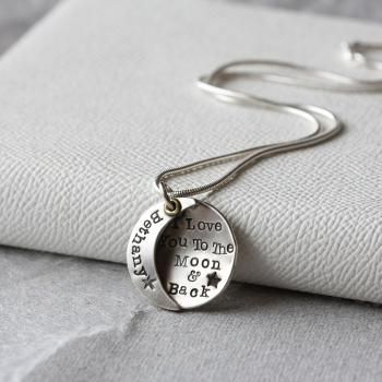 A gorgeous, handcrafted silver pendant, featuring full and crescent moons fused together and personalised with your choice of name. The sentiment behind the message says it all - 'I Love You To The Moon & Back'