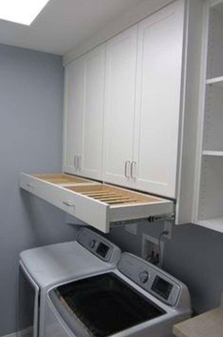 Hidden pull out drying racks.