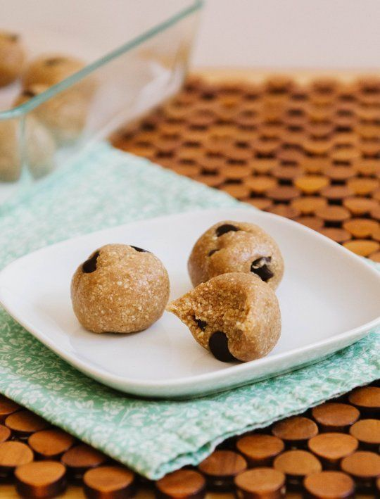 Raw Chocolate Chip Cookie Dough Bites Yields 12 bites  1 cup raw cashews 1/2 cup old-fashioned rolled oats (if you're gluten-free, make sure you're using gluten-free oats) 1/4 teaspoon salt 1/2 teaspoon cinnamon  3 tablespoons maple syrup 1 tablespoon vanilla extract 1/4 cup chocolate chips