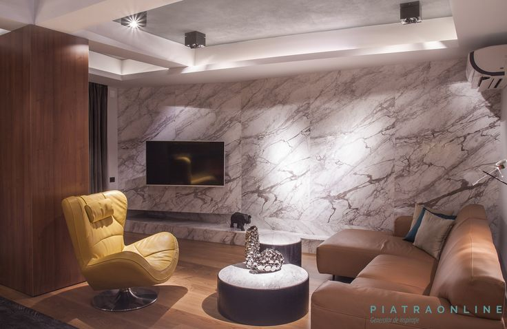 Open space: living and kitchen. Urban modern design, elegant minimalism. Walls cladded with Calacatta marble. Apartment in Bucharest, Romania.