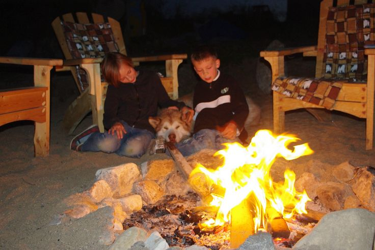 Warming up by the Campfire at Lucien Lake.  #lucienlake #campfire #roastingmarshmallows #summerfire #lakelife #lakefrontlots #rvlots