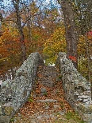 An old stone bridge over a creek in the Pocono Mountains of Pennsylvania. Falls into the stone wall category ...