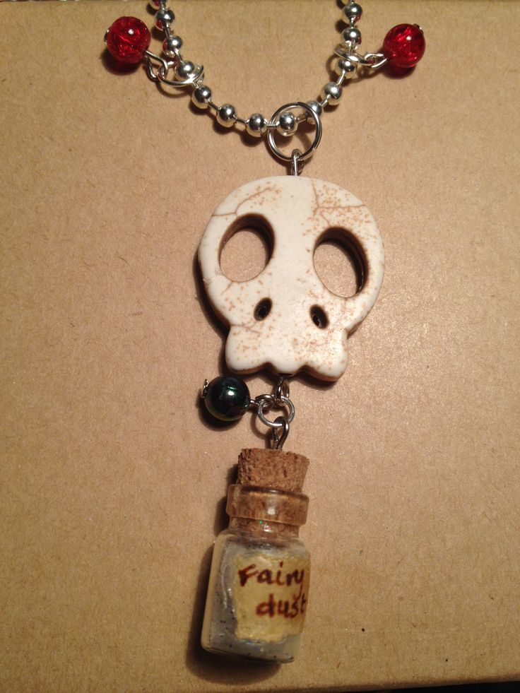 Necklace with a large howlite skull and a bottle of glittery old fairydust (embossingpowder)