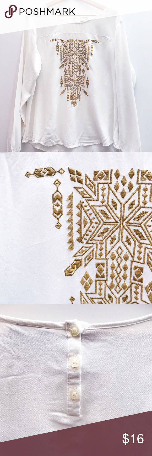 Embroidered Rayon Tolp This pretty, slouchy Top has so many cute details. Sheer shoulders, gold embroidery, button back and elastic at the wrists. Looks great tucked into jeans or worn loose over leggings. Ariat Tops Blouses