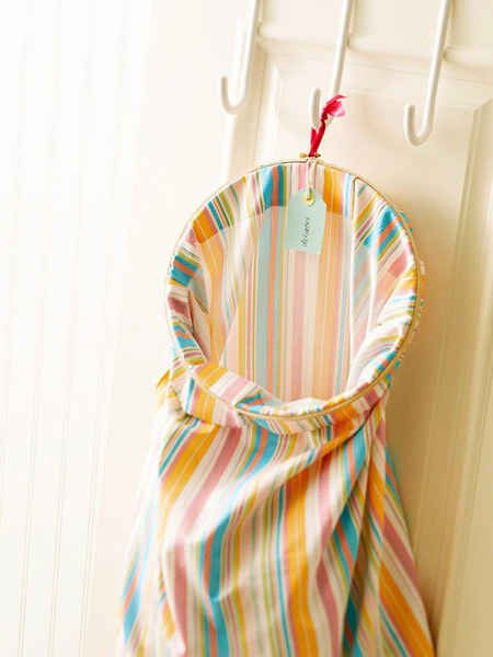 Try freeing up floor space by hanging a laundry bag from a hook instead.