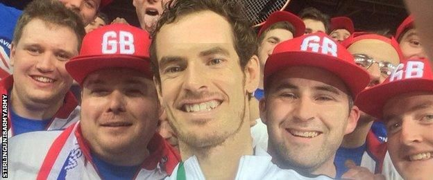 Andy Murray poses with fans