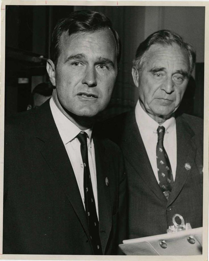 11/03/1964 - U.S. Senate candidate George Bush with his father, former U.S. Sen. Prescott Bush, realize it's bad news when the election results come in Tuesday night. Bush lost to Democrat Ralph Yarborough.  Photo: Jim Cox, Houston Chronicle / Houston Post files