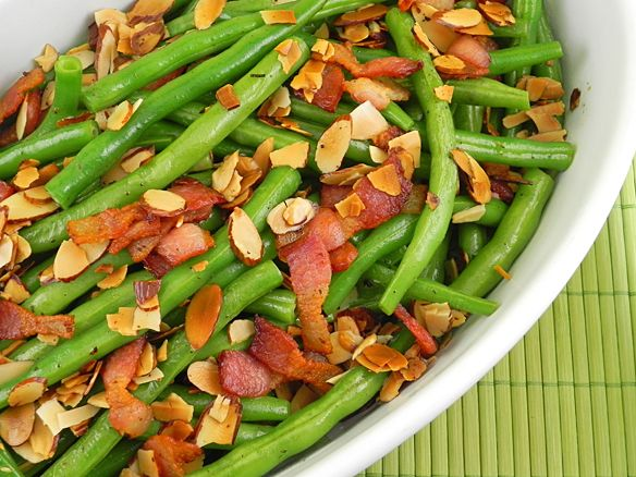 """""""I'm making green beans and bacon to go with the steaks for this event,"""" Joan said as she twisted the can opener around an industrial-sized can of green beans. A crowd of twenty gathered awaiting t..."""