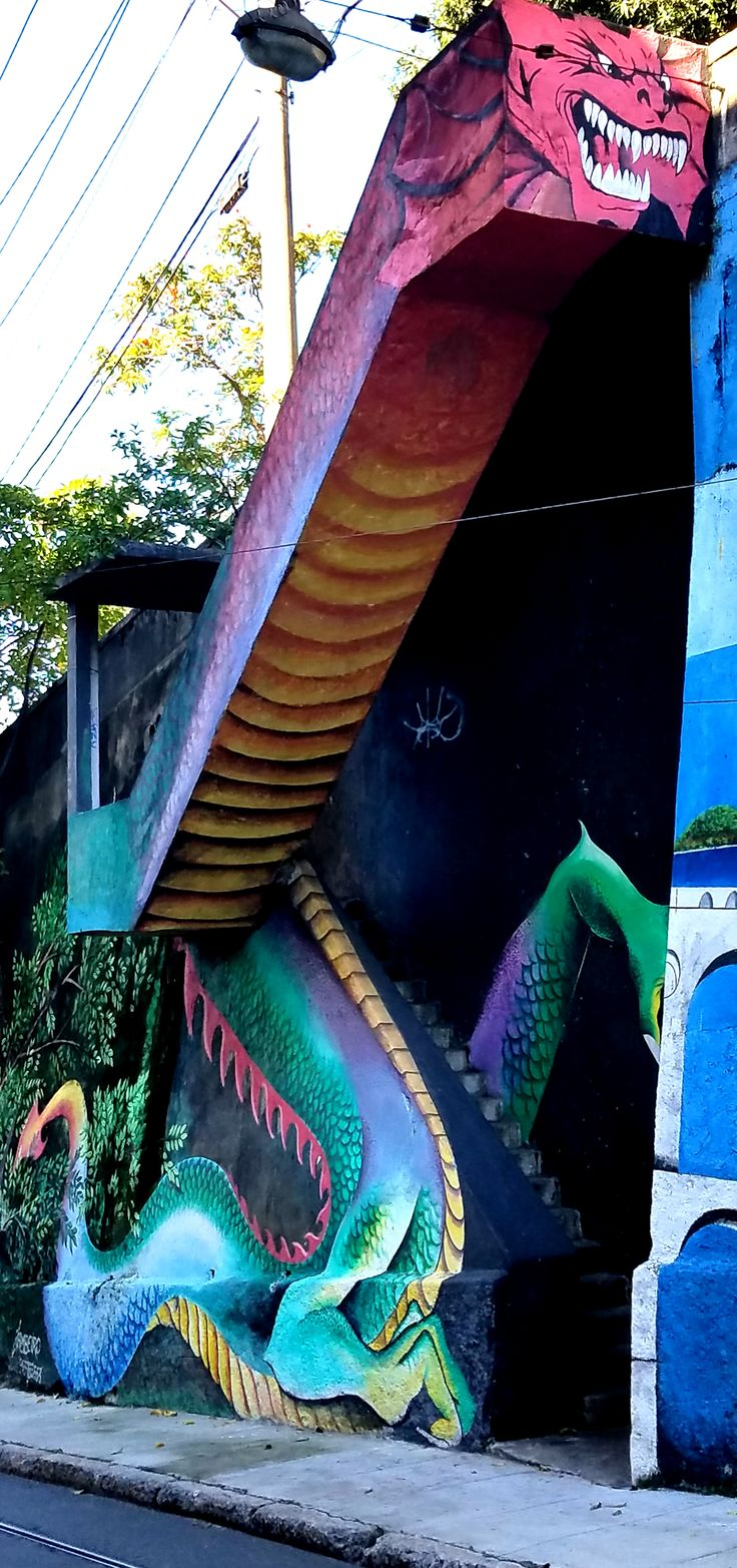 Rio de Janeiro, Brasil - Street Art & Graffiti from the Santa Teresa neighborhood in Rio. Very cool use of public stairs! Oh, Rio with its city filled with Street Art!!!  Original Photograph by R. Stowe.