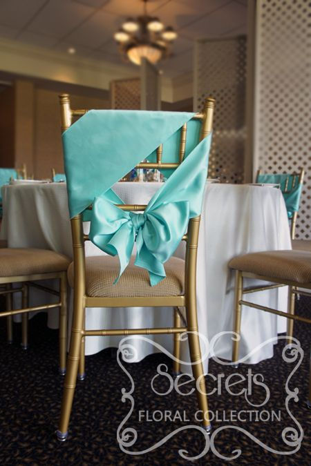 Close-up of chiavari chair, demonstrating how we have tied sashes in a unique way (diagonally)!