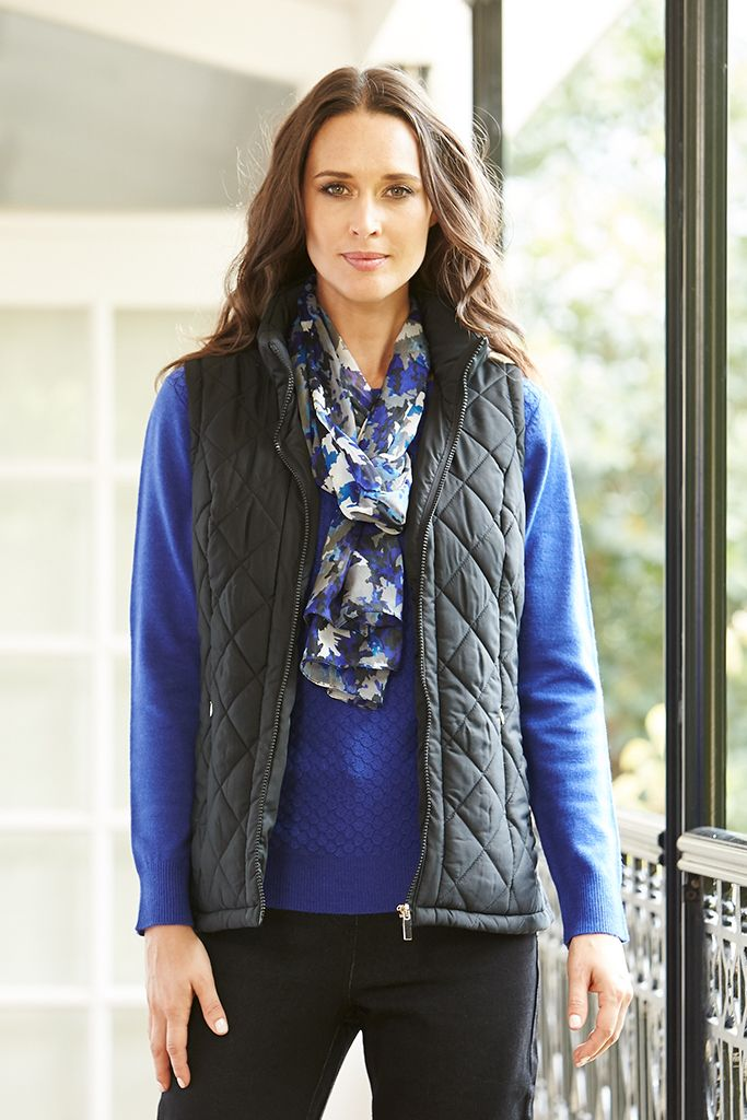 QUILTED VEST This quilted vest is a stylish addition to your leisure wear wardrobe. Sophisticated & practical, this high collar style is easy to layer & will match perfectly with all of your knits & long sleeve tops.