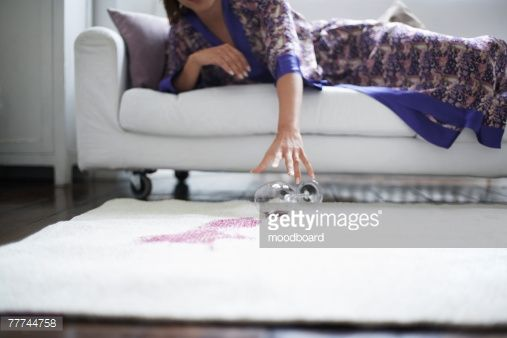 Stock Photo : Woman Reaching for Fallen Wine Glass