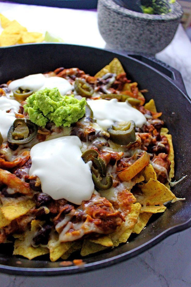 These chicken chili nachos are a perfect party dish! Surprisingly quick to put together, you can make them even easier by using pre-cooked chicken.