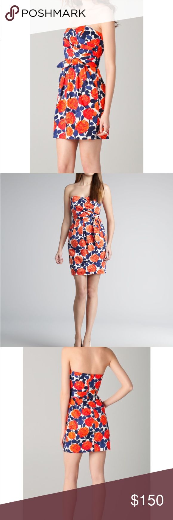 Shoshanna Floral Dress A retro-inspired floral-print is brought to the modern day with a slim, strapless silhouette. Persimmon (orange)/navy/white floral-print sateen. Strapless sweetheart neckline. Tonal sash waist. Box-pleat tulip skirt. Hidden back zip. Cotton/nylon/spandex. Dry clean. Imported. Shoshanna Dresses Mini