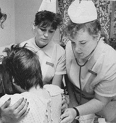 St. Vincent Hospital Nursing Students caring for AIDS patients in 1980's NYC a new area in patient care Operated by the Sisters of Charity of St. Vincent de Paul. The school nurses caps resembled the French Daughters of Charity winged Bonnet