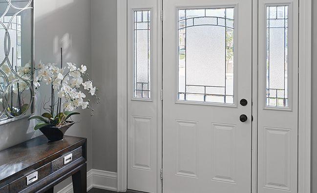"Steel panel door with a 22""x36"" decorative doorlite and two sidelite panels with decorative lites entry system.  Learn more about Casa Bella's Steel Door systems here: http://www.casabellawindows.ca/product/steel-entry-doors/"