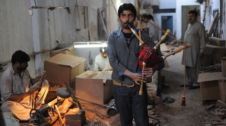 Ibrahim Ahmad, the son of the owner of the Imperial Bagpipe Manufacturing Co., tests a bagpipe at a factory in Sialkot, Pakistan. The Pakistani city is the largest producer of the instruments most commonly associated with Scotland. -NPR