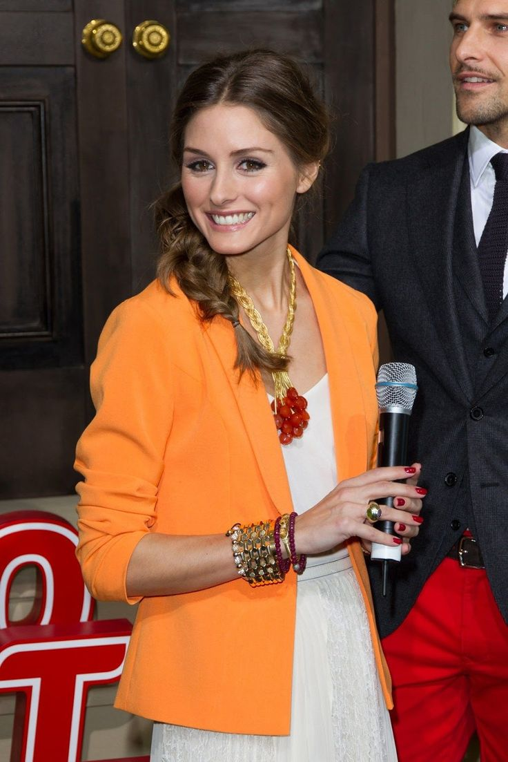 Great styling of the orange blazer... many people would not know how to wear this... Olivia Palermo | http://getthelookoliviapalermo.blogspot.com.es