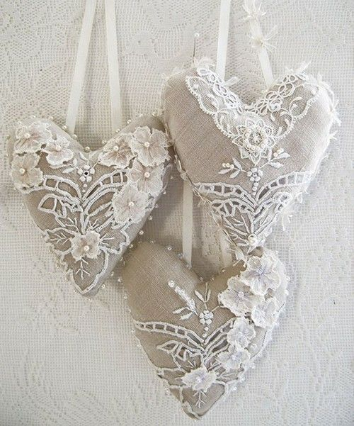 linen and lace hearts.  Would be pretty hanging from chairs at a wedding.