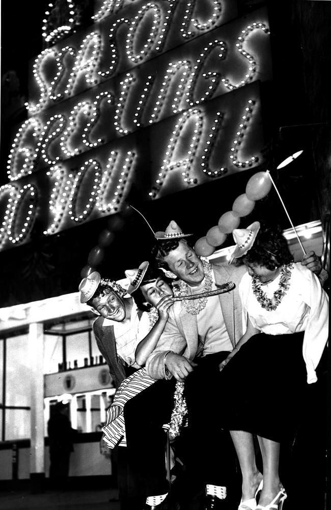 """1 January 1957: Graham Horn, Lillian Stiles, Peter Hunt and Julie Barlow were all dressed up for New Year's Eve at Luna Park. The original caption noted that the group had """"a gay time"""". Picture: Herald Sun Image Library/ ARGUS"""