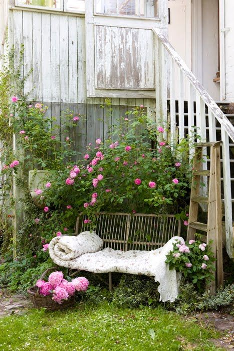 Relaxing place in the garden - pink roses shabby paint white woodwork stairs mmmmm.