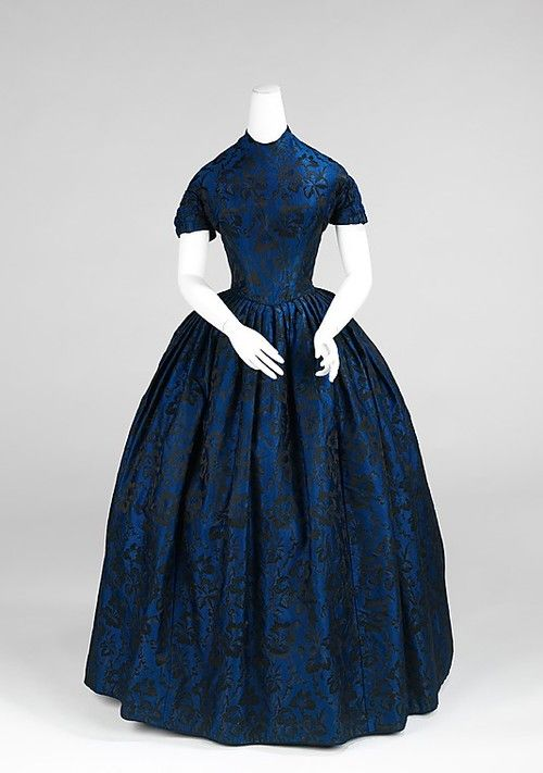 Instinct says either a day dress or a dinner dress, but the short sleeves throw me! 1850-1852.