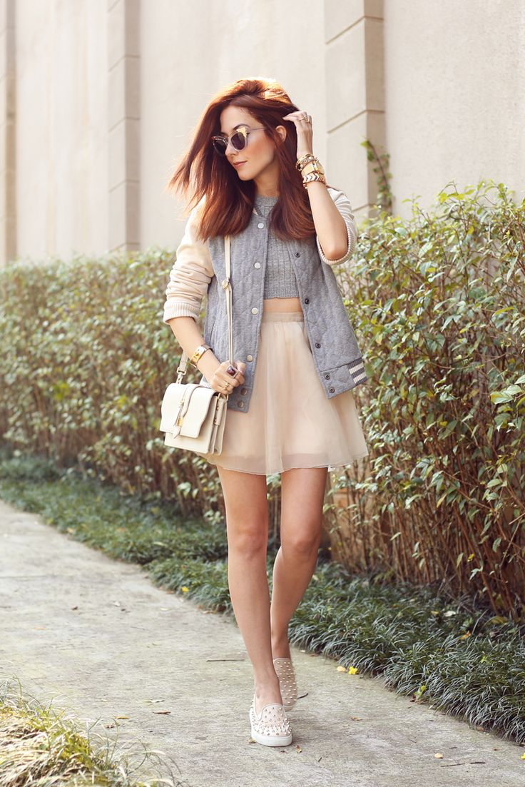 Girly outfit wearing Gap bomber jacket in nude and gray with tulle skirt, for a perfect high low mix. Also wearing spiked shoes and cat eyes sunnies.