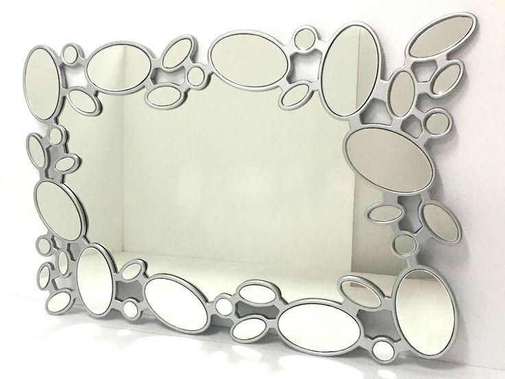 Espejo moderno rectangular con formas ovaladas color plata for Espejos decorativos con formas