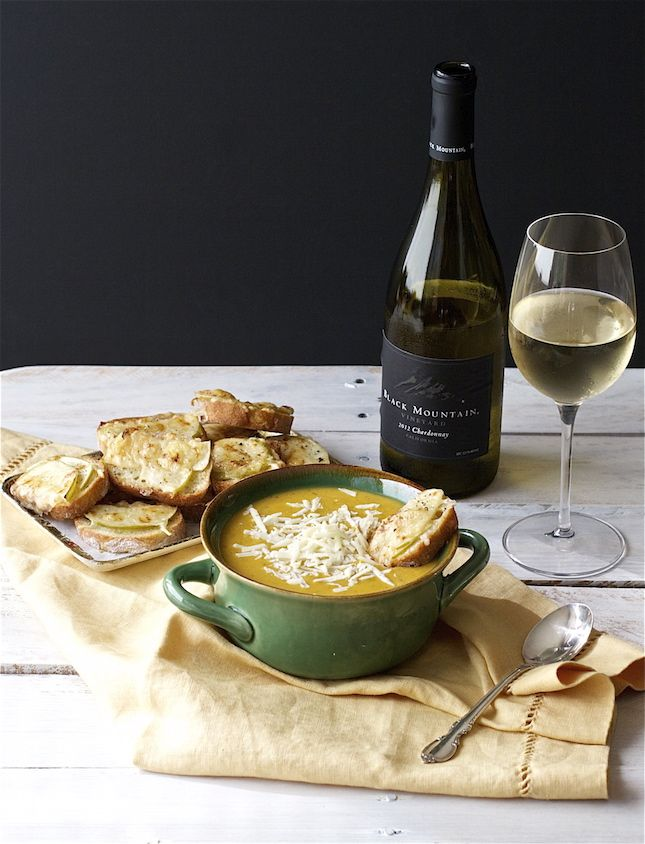This Butternut Squash + Apple Soup with Apple-Gruyere Crostini looks SO mouth-watering.
