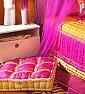 Bold and Bright colro pallette of Fuschia, Orange and Gold with Lace Trims in gold accents make this bedding desirable for everyone young at heart