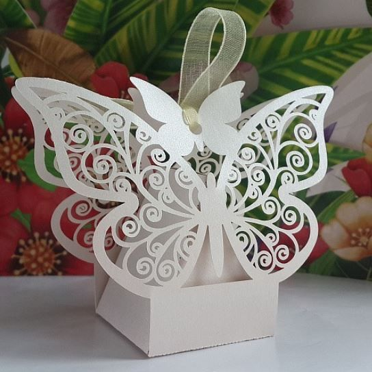 50 Pieces of Laser Cut Pink or White Pearlescent Butterfly Wedding Candy/Chocolate Boxes For the Reception or Wedding Favor Gift Boxes with Ribbon.  THE INNER BOX IS IN THE SHAPE OF A PYRAMID/TRIANGLE.  Favor box is made of glossy, heavyweight paper with a laser cut pattern that can be filled...