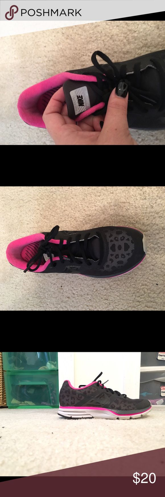Black and pink cheetah printed Nike shoes Mostly black with a grey cheetah print, pink accents. Great running shoes, size 8 Nike Shoes Athletic Shoes