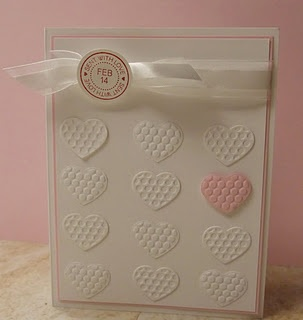 Rows of small embossed white hearts and one pink