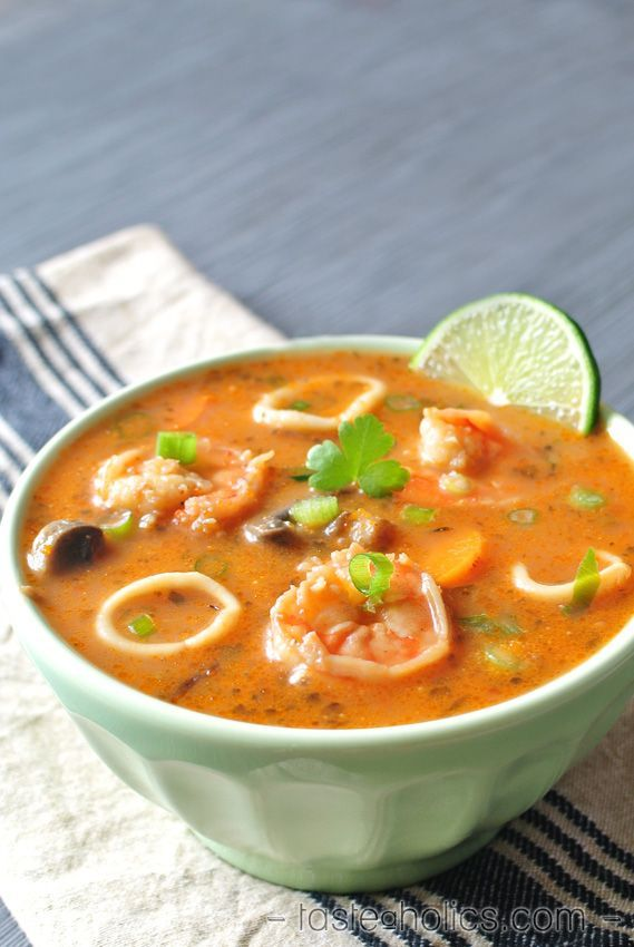 Delicious and impressive paleo seafood soup made with wild caught cod, shrimp and calamari! It's swimming with hints of lime and fresh parsley! More recipes like this at www.tasteaholics.com