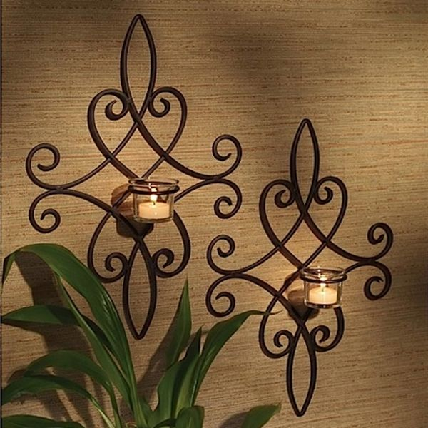 this pair of iron wall sconces can be displayed at graduated heights or sideby