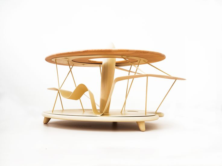 Leo, coffee table inspired to  aerial screw drawing of Leonardo da Vinci. Leonardo the invention turns into a futuristic wooden and iron coffee table. Hane Design Made in Italy