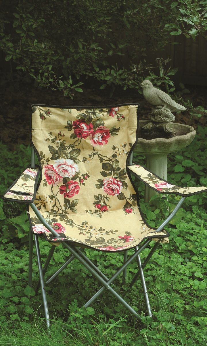 Glamour & Camping. Sumptuous chintz roses are spattered across a field of buttery yellow cotton canvas. This romantic lawn chair folds into a carrying case.