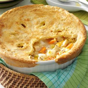 Cheddar Chicken Potpie Recipe -Cheese soup is one of my favorites, but it's a bit too rich for my husband's tastes. So, by changing the ingredients a little, I came up with a variation of potpie we both enjoy. (If I'm in a hurry and don't have the time this takes to bake, I'll leave off the crust, add extra milk and serve it as a chowder.) —Sandra Cothran, Ridgeland, South Carolina