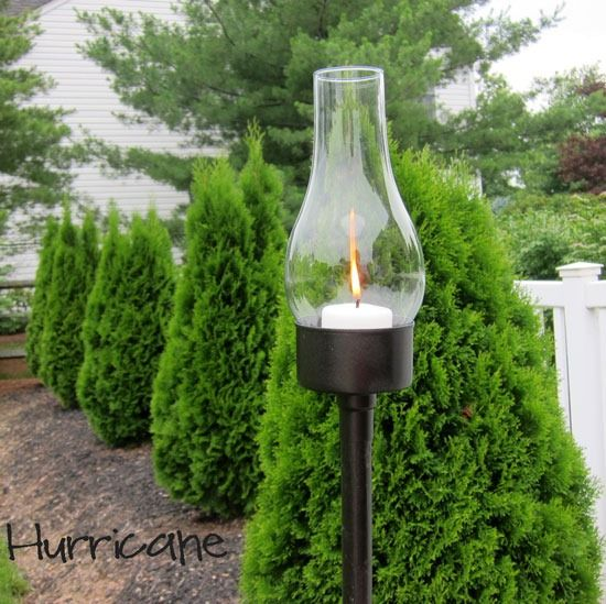 Candle-Lantern from tuna can, thrift store hurricane lampshade, wooden post