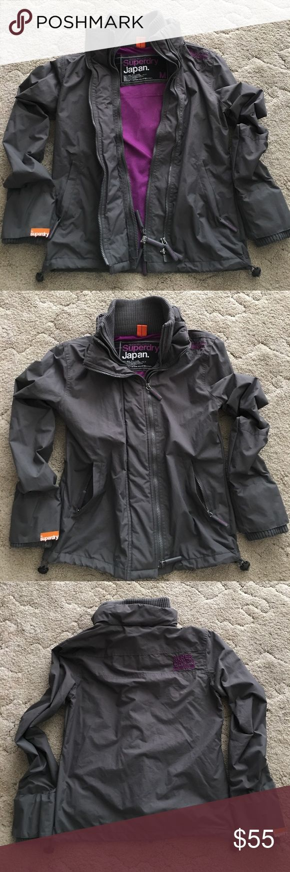 "SuperDry Jacket/Coat - Medium SuperDry windbreaker-type jacket in size Medium. Medium gray with purple interior and detail. Purchased in used condition from eBay seller and only used a few times myself. Good condition. Approx measurements: 19"" armpit to armpit, 23"" tip of shoulder to bottom hem, 19.5"" armpit to end of sleeve. ➡️ Open to offers ⬅️ Superdry Jackets & Coats"
