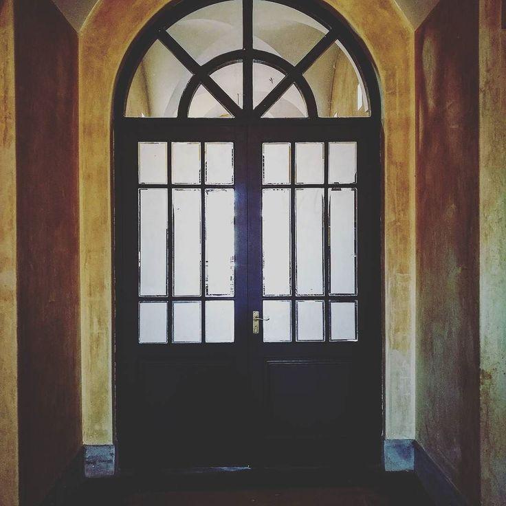 Arched double doors with white translucent safety glass adding that extra privacy as well as a touch of elegance and warmth between the to the rustic painted walls. #indoordesign #exteriordesign #weddingvenues #doubledoor #swingdoor #doorframe #doordesign  #retrodoors #dooroftheworld #doorstagram